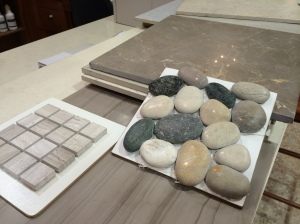 bath tiles for upper baths-- the small mosaic tile is just a sample -- that tile will be in larger pieces -- it is a marble tile in birch wood and drift wood  the pebbles are the accent walls