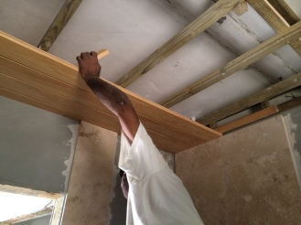 cypress ceiling being installed in the new bath