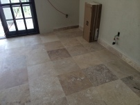 new travertine flooring in the 'new' bedroom
