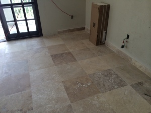 new travertine flooring in the 'new' bedroom