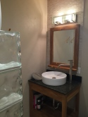 New lower bath with glassed in shower